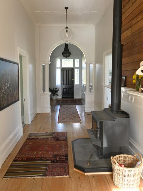 The generous hallway has rimu flooring and a 3.5m stud. The owner exposed the sarking behind the...