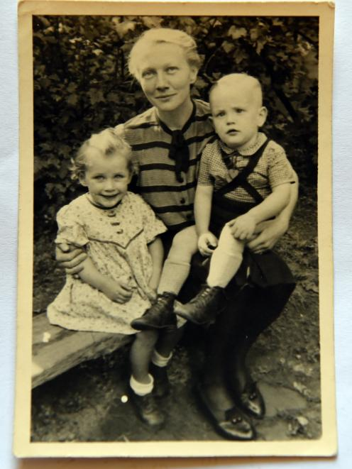 In 1943, Lilo, widowed, poses for this photograph with her two children Heinke and Hartmut.