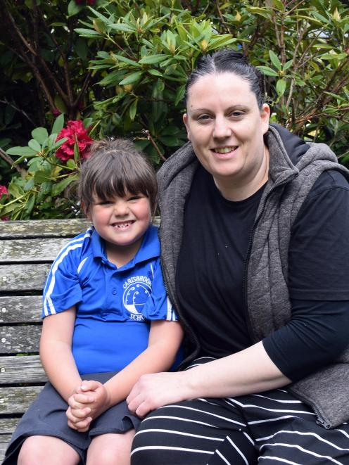 Carisbrook School pupil Charlie Proctor, of Caversham, (with mother Heidi Proctor) was born on...