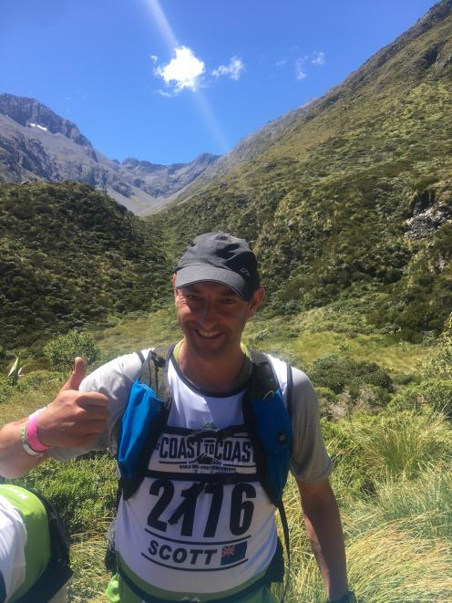 Scott Weatherall at the  top of  Goat Pass on the Coast to Coast on day 1. Photo: supplied