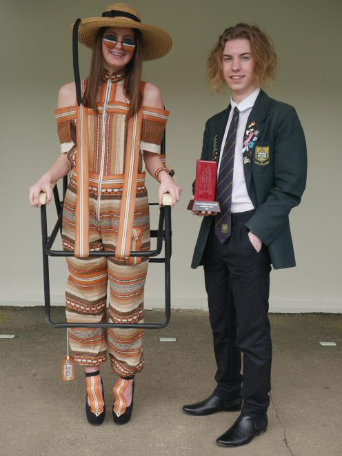 Bayfield High School pupil George Park  shows  the outfit,  modelled by fellow pupil Tahlia...