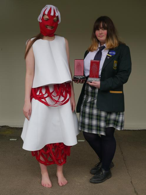 Eden Poll models the outfit designed by  fellow  Bayfield High School pupil Alice Parsons  which...
