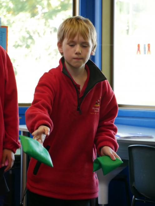 Mornington School pupil Lachlan Gascoyne (9) throws a bean bag during a game in the school's Play...