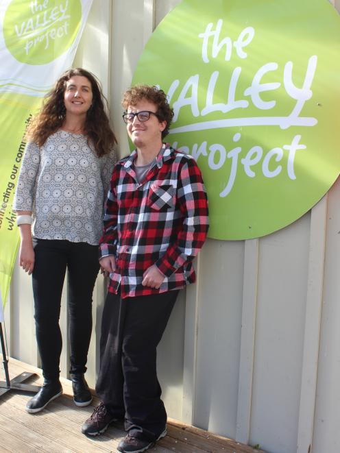 Rorie White celebrates his last week at The Valley Project with workmate Anna Parker. PHOTO: ELLA...