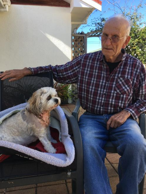 Jack Holland (84) at home with Riley, who is recovering after being attacked by two dogs last...