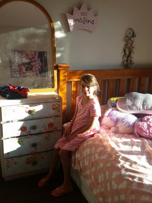 Ariah  in her bedroom before it received a makeover by Make-A-Wish.  PHOTO: SUPPLIED