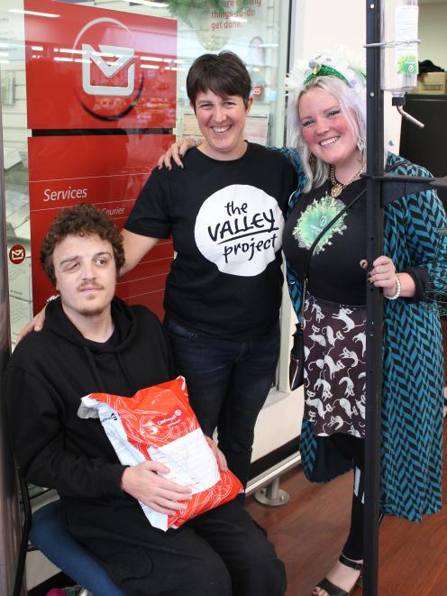 Rorie White posted a parcel to Prime Minister Jacinda Ardern, with Charlotte Wilson (centre),...