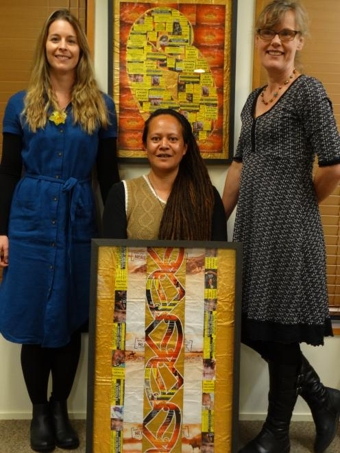 Palmerston-based artist Annejennette Maki (centre) is joined by Cancer Society Otago-Southland...