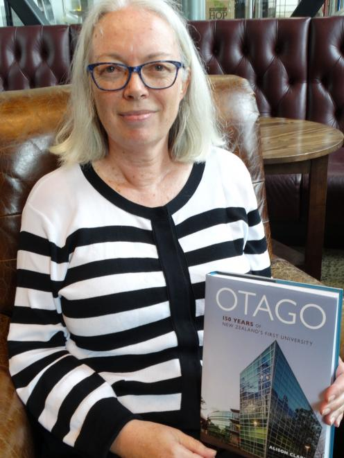 Historian and University of Otago graduate Dr Ali Clarke with her themed history of the...