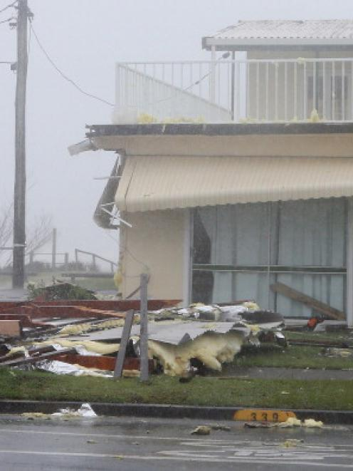 Police at the scene of a roof collapse in Tugun as Queensland experiences severe rains and...