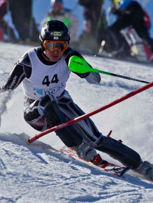 2011 Super G, giant slalom and slalom national champion Ben Griffin, of Ohakune, competes during...