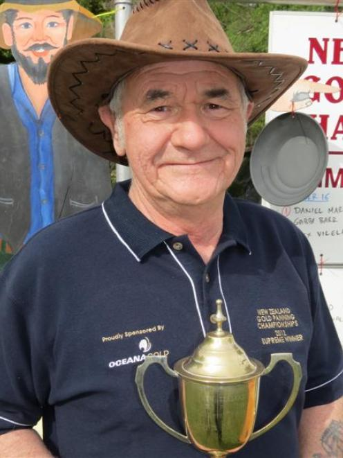 2012 New Zealand Gold Panning Champion Bill Lind, of Balclutha, with his trophy after the...