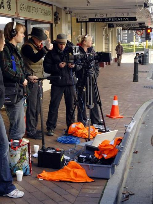 38 Pictures crew film episode four of Casebook in Lower Stuart St, Dunedin, yesterday. (From left...