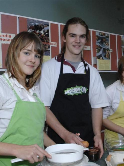 Logan Park High School pupils (from left) Casey Broad, Declan Smith and Gina Manning show their...