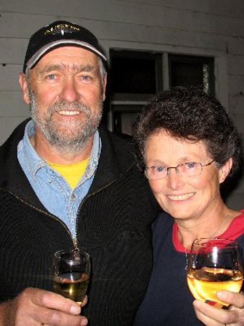 Brian and Penny Anderson, celebrate after buying Waikouaiti's old school house last night. Photo...