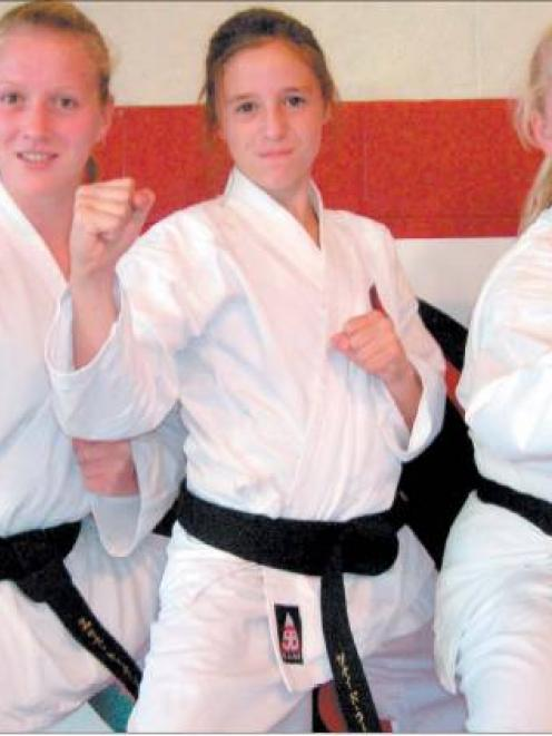 Don't mess with me: West Otago Karate Club's three new black belts are, from left, Cherise...