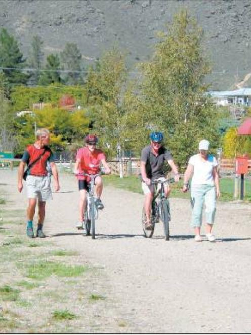 Enjoying the surroundings: Travelling along the newly beautified section of rail trail are...