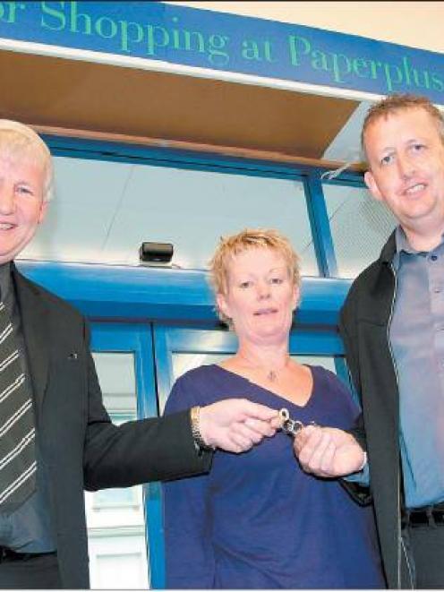 Handing over the keys: Gore Paper Plus owner David Preston (left) handing over the keys to new...