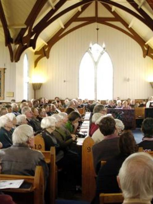 Presbyterian minister the Rev John Sinclair preaches to a packed Pukehiki Church on the Otago...