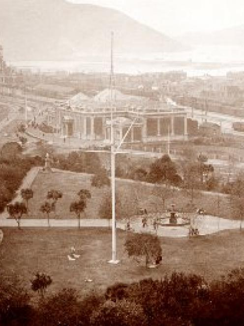 This panoramic view shows Queens Gardens in foreground, the Otago Early Settlers Association and...