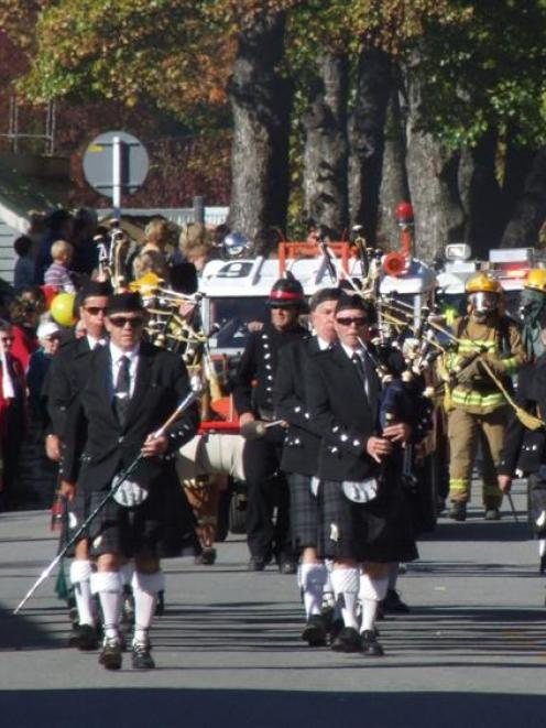 Crowds watch the 24th annual Arrowtown Autumn Festival parade on Buckingham St. Photo by Chris...