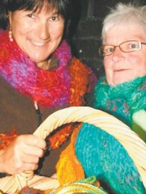 Take a spin: Hoping to raise interest in a scarf competition are Gore Spinners and Weavers Club...