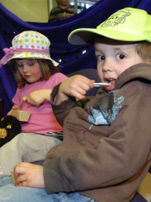 Imogen Yates (3), left, and Odin Jacobs (4), both of Dunedin, tuck in to chocolate ice-cream at...