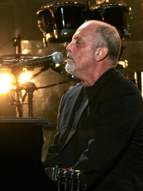 Billy Joel performs at Shea Stadium in New York. Photo Frank Franklin II/AP