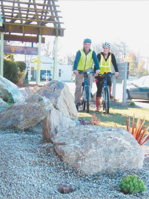 Pedal power: Central Otago District Council staff members Matthew Sole and Sophie Mander are...