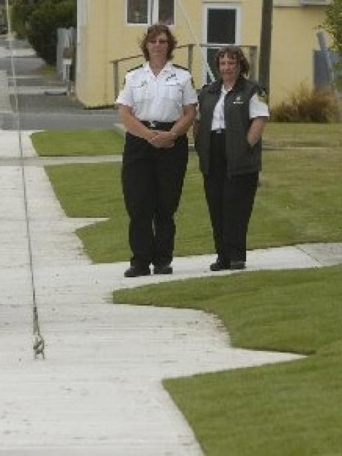 St John first aid officer Jan-Marie Fitzgerald and paramedic Laura Vincent look at a guy rope...