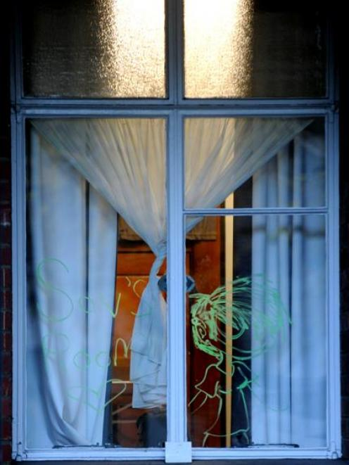 A ghostly apparition appears in a window of Cumberland Hall yesterday. Photo by Craig Baxter.
