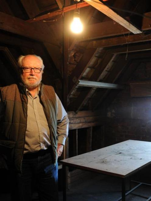 Australian heritage conservator Chris Betteridge checks out the attic of the former Dunedin...