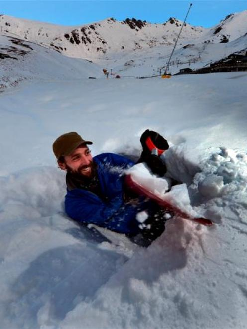 Blair Whitaker (33), of Queenstown, scouts for locations for his home for a month, a snow cave....