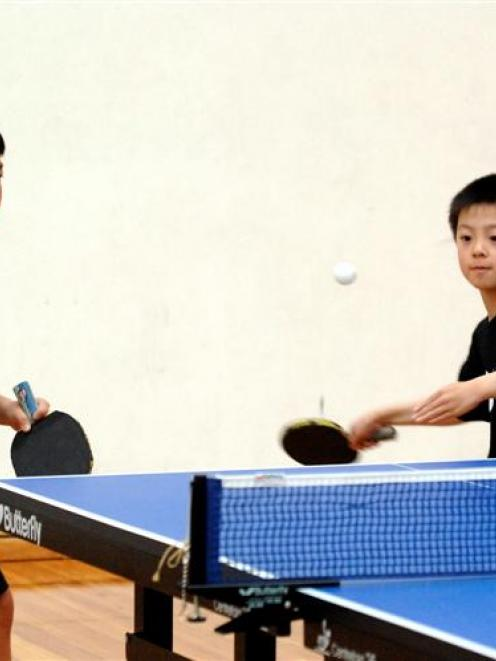 Brothers Logan (left) and Nathan Xu train at the Lion Foundation Arena in Dunedin yesterday....