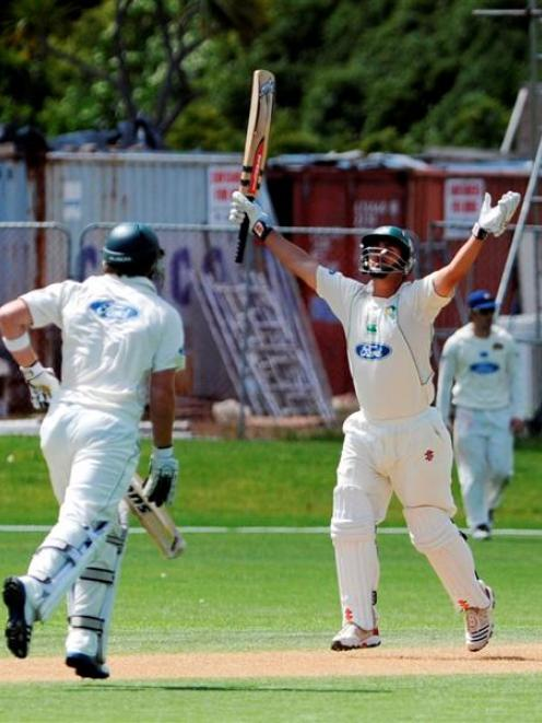 Central Districts batsman Mathew Sinclair runs through to complete his century during his team's...
