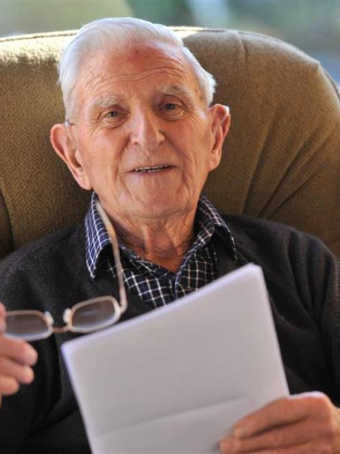 Eric Lundquist, at his home in Brooklands Village, Mosgiel, reads through letters received from...