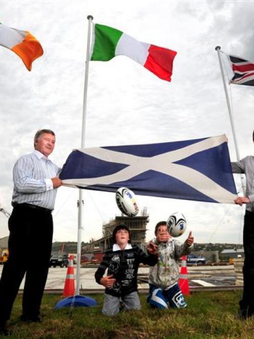 (From left) Dunedin deputy mayor Syd Brown, Jack Leslie (9), Tom Hume (10) and former Scottish...
