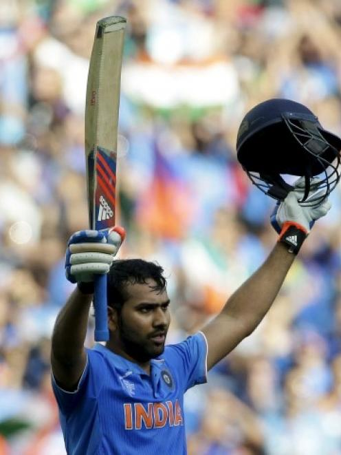 India's Rohit Sharma celebrates reaching his century against Bangladesh in Melbourne. REUTERS...