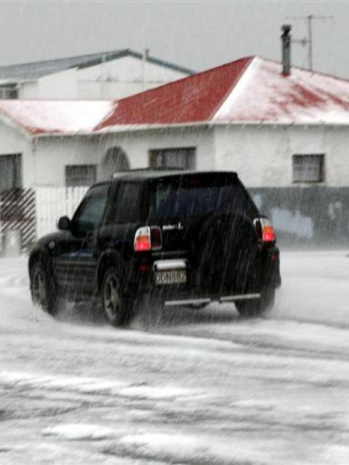 Invercargill summer . . . Hail covers the road in Invercargill during a storm that sent...