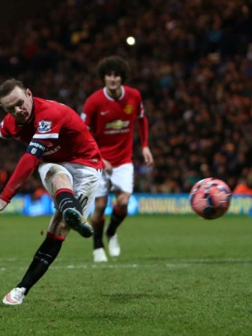 Manchester United's Wayne Rooney shoots to score their third goal against Preston North End....