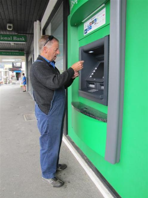 Mt Aspiring College caretaker Ronnie Moffat, of Wanaka, checks his bank account to see if he  has...
