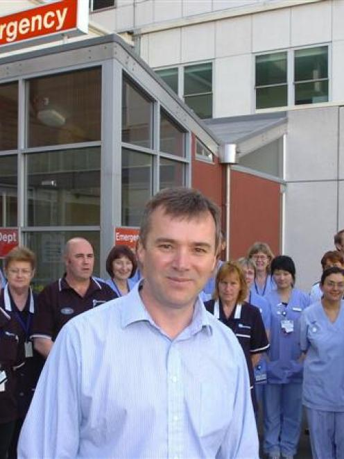 """Putting our Patients First"" project leader Dr Tim Kerruish stands with emergency department..."