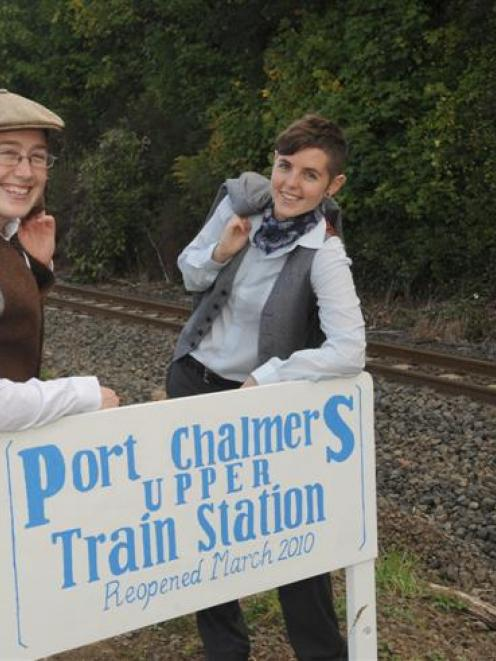"""Stationmasters"" Sarah Orchard (left) and Joe MacDonald get ready for Port Chalmers commuters..."