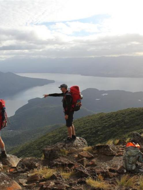 Taking in the vast landscape of the Kepler Track Great Walk - one of the nine being hiked  back...