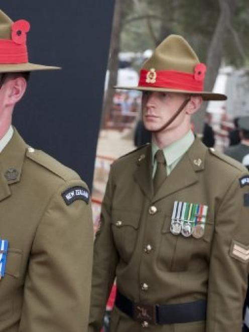 Trooper Morgan Formston (left) prepares to march on with the catafalque guard at the Anzac Day...