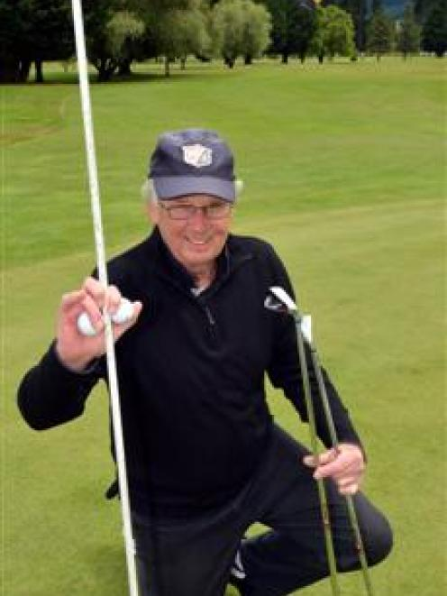 Twelve Oaks golfer Les Wilson celebrates his two holes in one in the past month. Photo by Gerard...