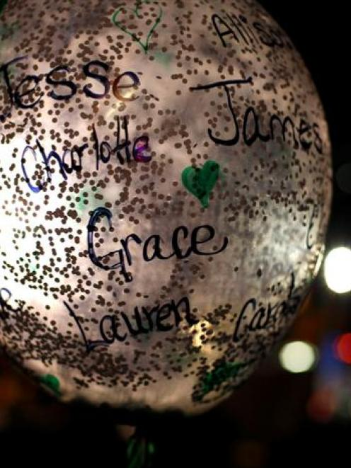 A balloon displays some of the names of the victims of the Sandy Hook Elementary School shooting...