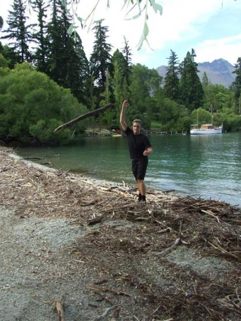 A Bathhouse staff member moves driftwood from in front of the restaurant yesterday morning. Photo...