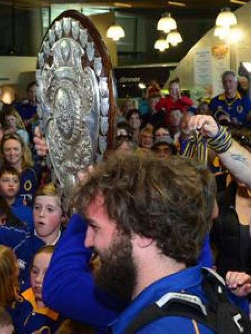 A bemused Liam Coltman looks on as the shield moves through the crowd.