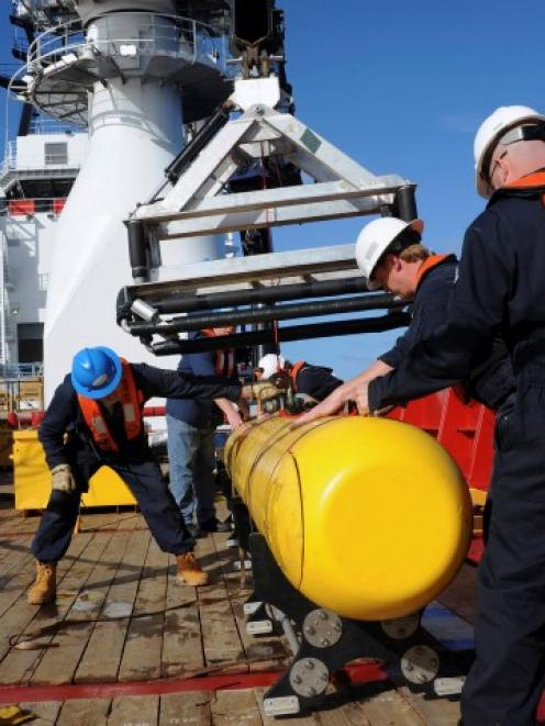 A Bluefin 21 autonomous underwater vehicle is hoisted on board the Australian Defence Vessel...